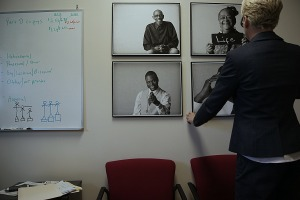 Amy Nelson is decorating her office walls with photos of former clients.
