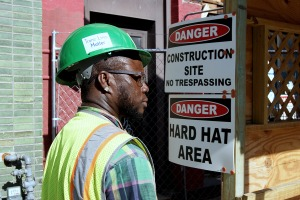 Achim Jeremiah Howard arrives at the construction site where he works in Washington, USA, 14 July 2015. He used to be called CeTenia Elizabeth-Renee Howard. Howard found the courage to live as a man after coming into contact with the Unity Fellowship Church. Photo: Charlotte Bouwman